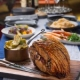 Roast Crispy Skin Pork Leg with Seasonal Sides