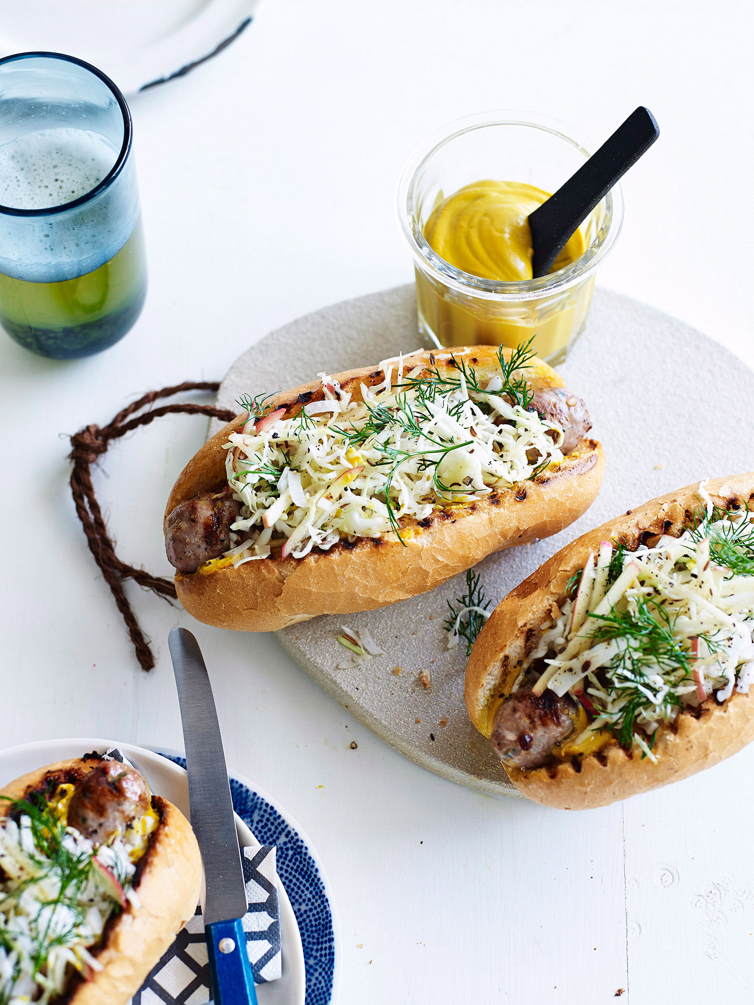 PORK SAUSAGES WITH CARAWAY SEED, CABBAGE AND APPLE SLAW